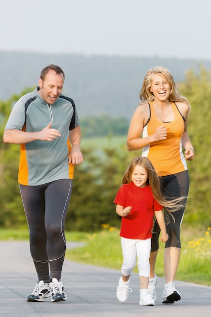 Family running for sport outdoors Premium Photo