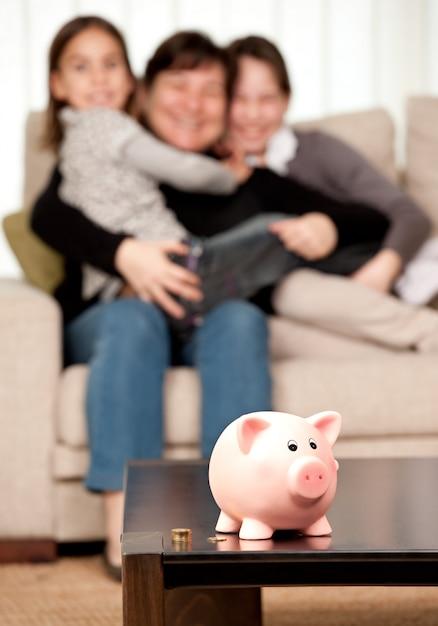 Family saving money on a piggy bank Premium Photo