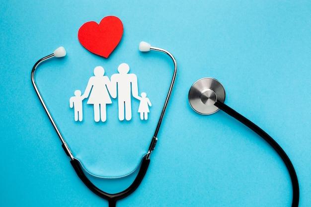 Family shape figure with heart and stethoscope Free Photo