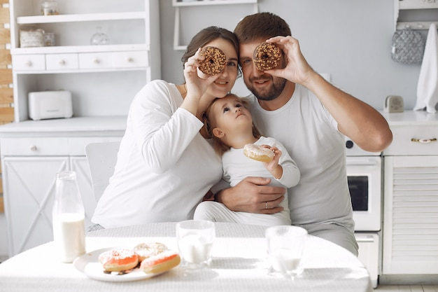Family sitting in a kitchen and have a breakfast Free Photo