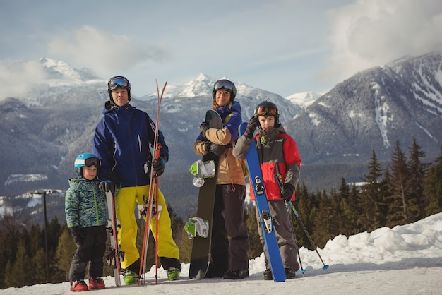 Family in skiwear standing together on snowy alps Free Photo