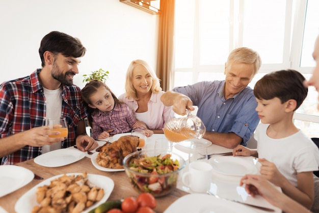 Family at the table celebrates a family holiday. Premium Photo