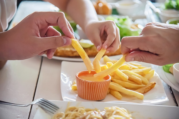 Family time eat french fries together Free Photo