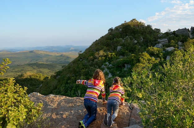 Family travel with children, kids looking from mountain viewpoint, holiday vacation in south africa Premium Photo