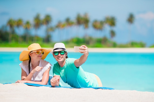 Family of two making a selfie with cellphone on beach Premium Photo