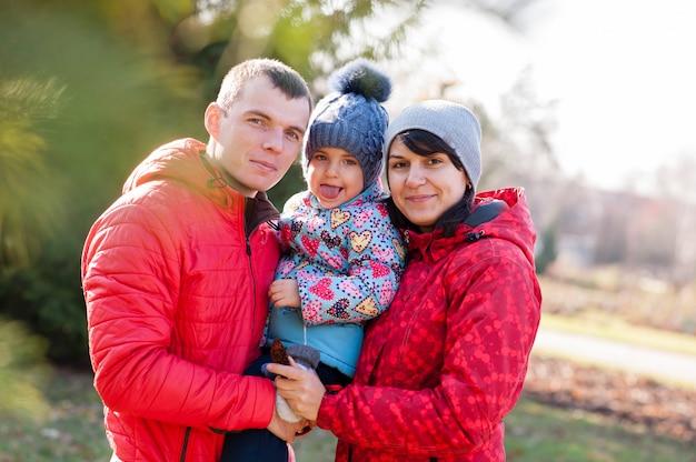 The family walks in the park in autumn Premium Photo