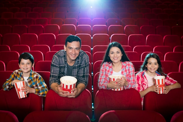 Family watching movie in cinema Free Photo