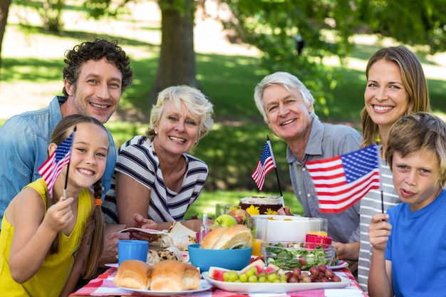 Family with american flag having a picnic Premium Photo