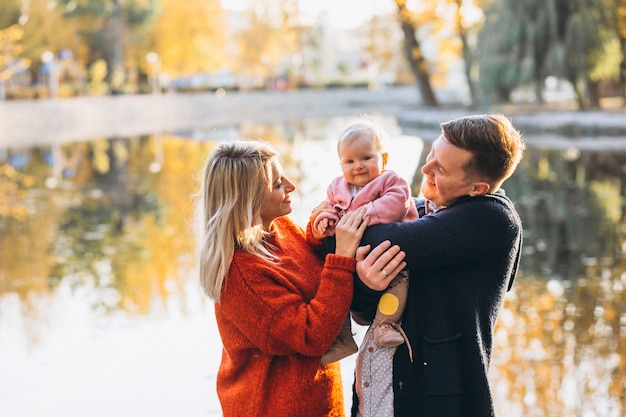 Family with baby daughter walking in park Free Photo