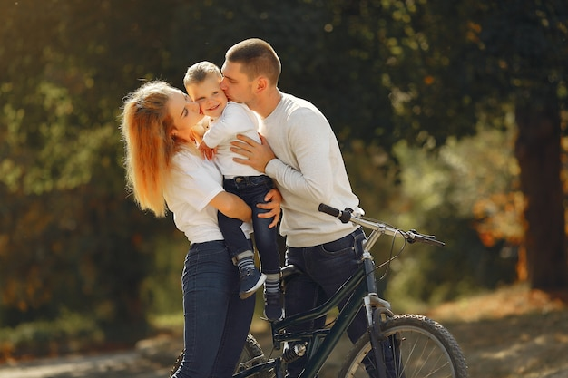 Family with a bicycle in a summer park Free Photo