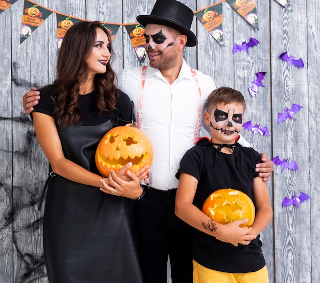 Family with carved pumpkins for halloween Free Photo