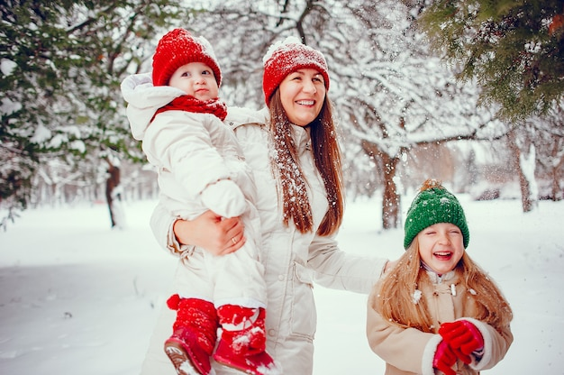 Family with cute daughters in a winter park Free Photo