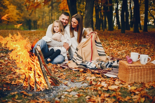 Family with cute kids in a autumn park Free Photo