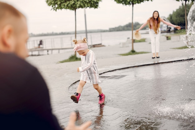 Family with daughter playing in a park Free Photo