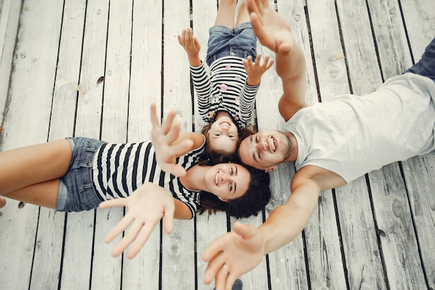 Family with daughter playing on a sand Free Photo
