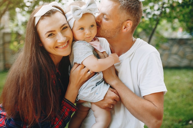 Family with daughter playing in the yard Free Photo