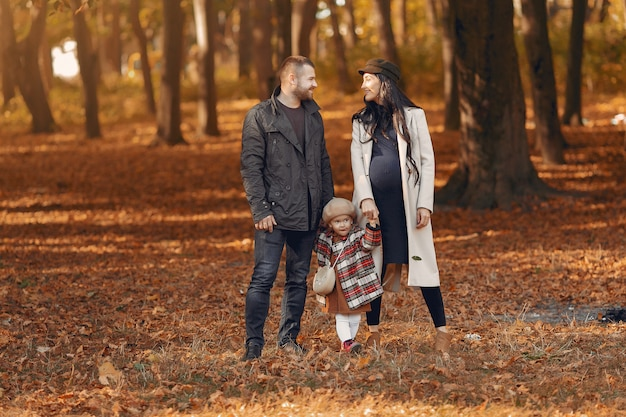Family with little daughter in a autumn park Free Photo