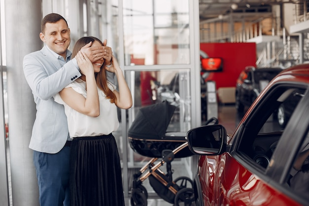 Family with little son in a car salon Free Photo