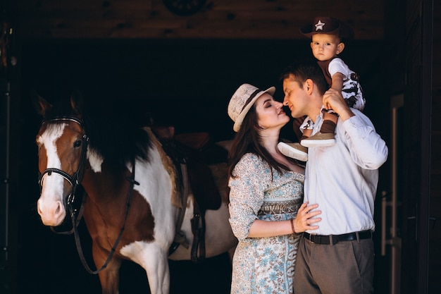 Family with little son at ranch Free Photo
