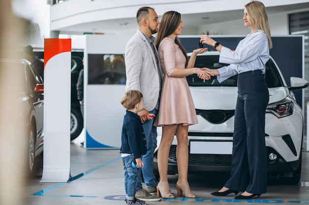 Free Photo | Family with son choosing a car in a car showroom