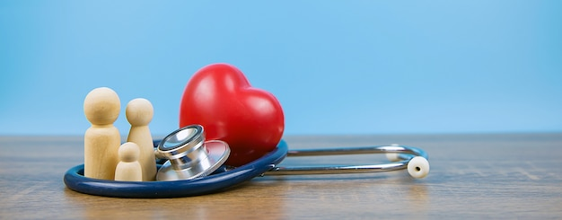 Family with stethoscope and a red heart, concept of a physical examination and health insurance. Premium Photo