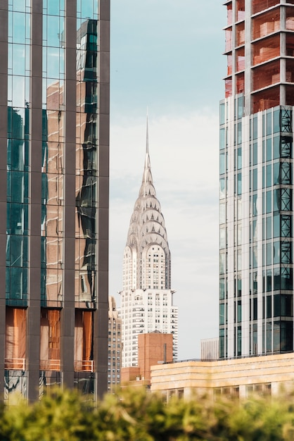 Famous chrysler building among characteristic neighbor skyscrapers Free Photo