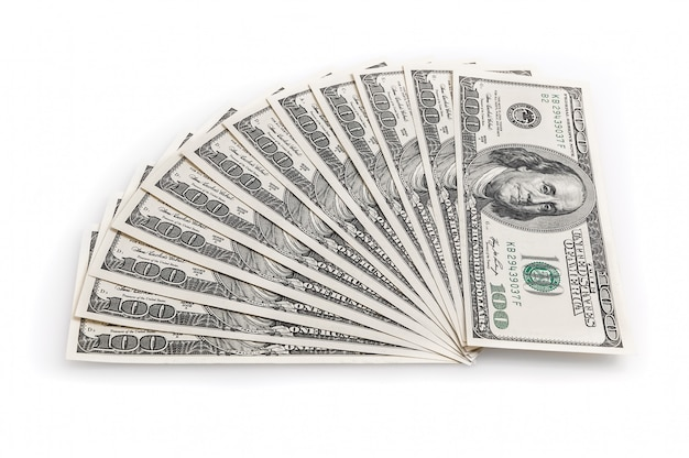 Fan of one hundred dollar bills on a white background. view from above. Premium Photo