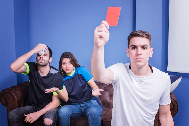 Fan showing red card Free Photo