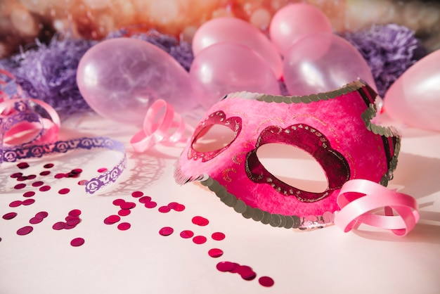 Fancy pink mask with party elements Free Photo