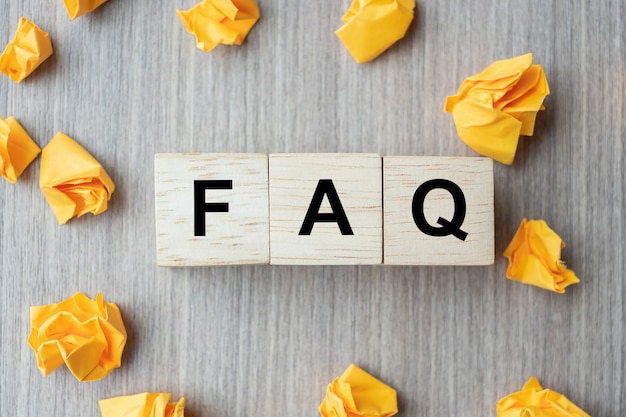 Faq( frequency asked questions) word with wooden cube block Premium Photo