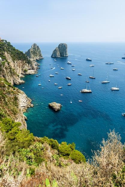 Faraglioni rocks near capri island in italy Premium Photo