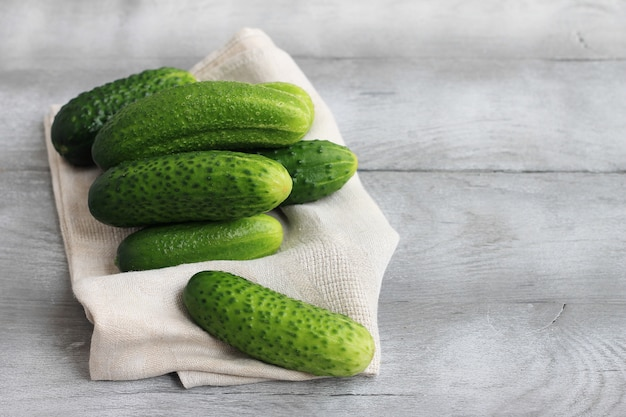 Farm cucumbers on wooden background. close-up, copy space. Premium Photo