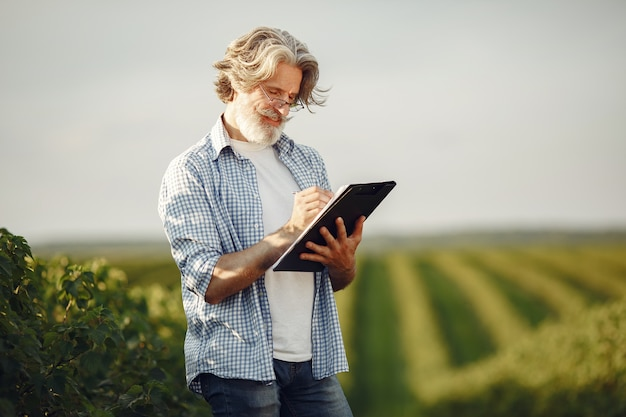 Farmer examines the field. agronomist or farmer examines the growth of wheat. Free Photo