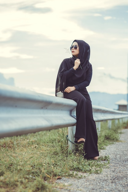 Premium Photo Fashi Portrait Of Young Beautiful Muslim Woman With The Black Hijab And Full Black Dress Vintage Style