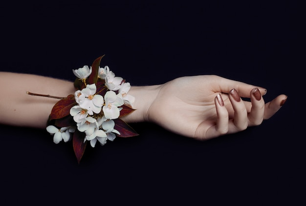 Fashion art hand woman in summer time and flowers Premium Photo