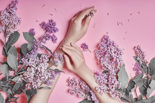 Fashion art hands natural cosmetics lilac flowers Premium Photo