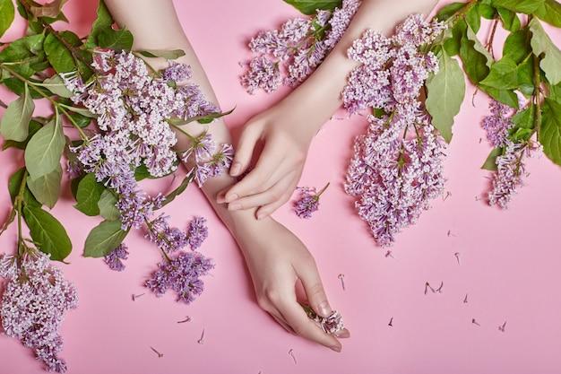 Fashion art hands natural cosmetics women, bright Premium Photo