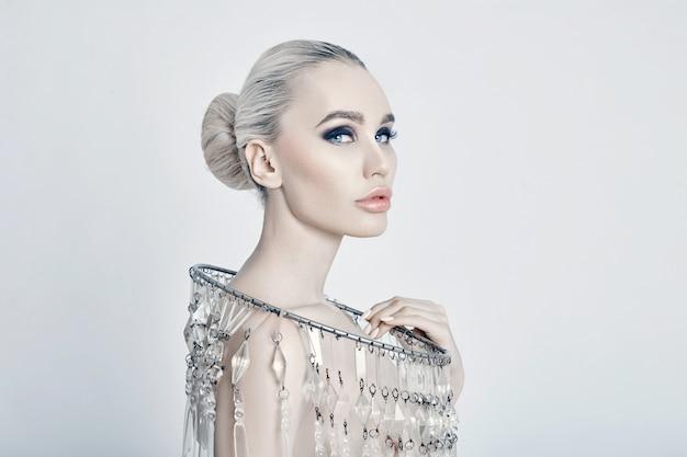Fashion art portrait of blonde big shiny necklace Premium Photo