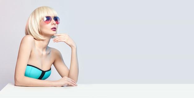 Fashion art portrait woman in swimsuit makeup Premium Photo