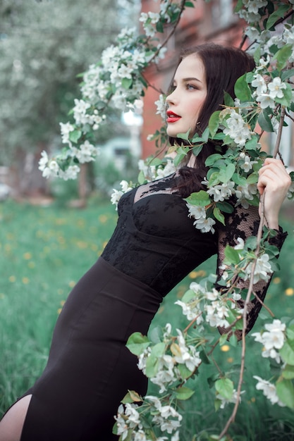 Fashion art woman in summer blossoming apple tree Premium Photo