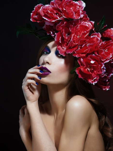 Fashion beauty model girl with flowers hair. bride. perfect creative make up and hair style Premium Photo