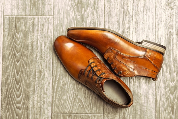 Fashion concept with male shoes on wooden Premium Photo