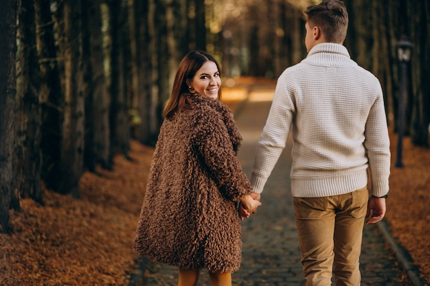 Fashion couple together walking in the park Free Photo