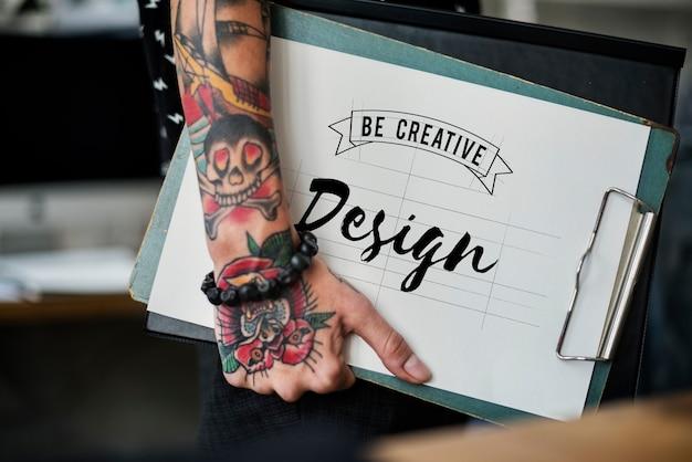 Fashion designer holding a clipboard Free Photo