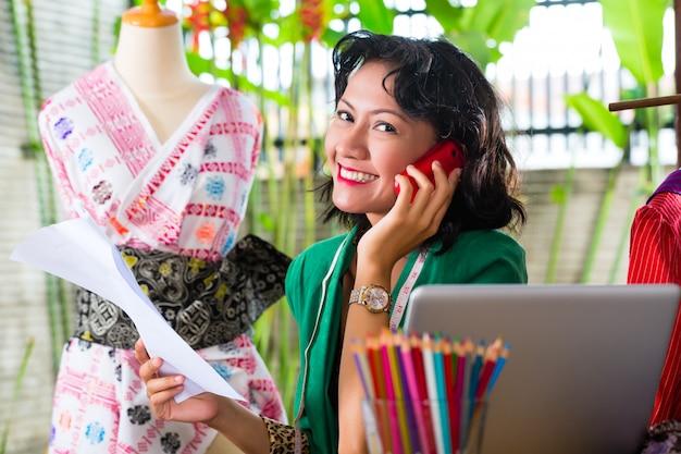 Fashion designer working at home Premium Photo