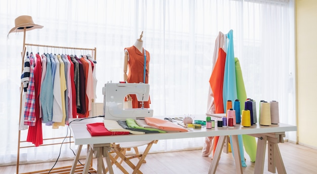 Fashion Designer Working Studio With Sewing Items And Materials On Working Table Premium Photo