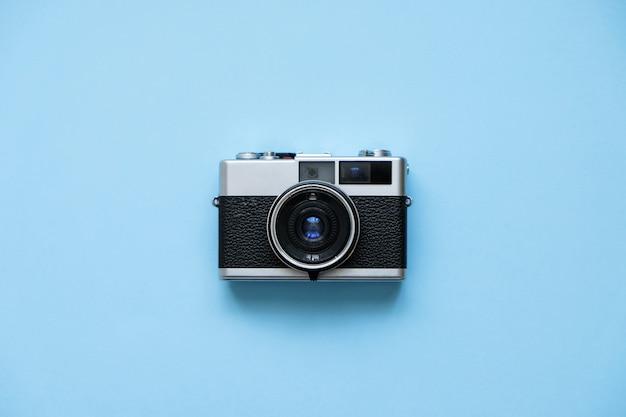 Fashion film camera on blue. retro vintage accessories Premium Photo