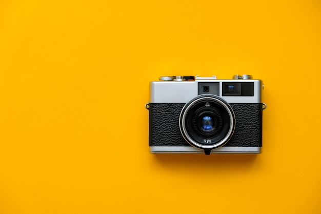 Fashion film camera on yellow. Premium Photo
