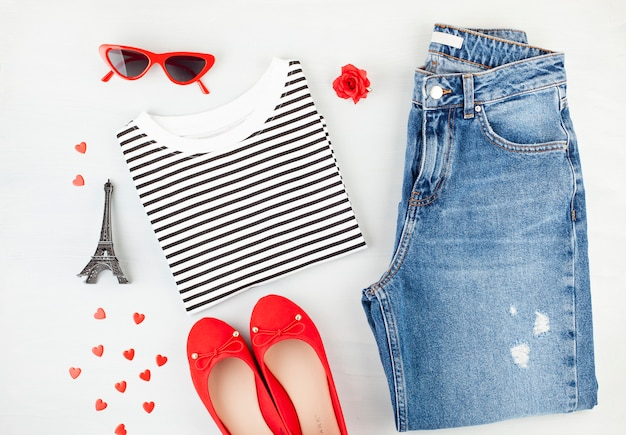 Fashion flat lay with french style girls urban outfit with t-shirt, ballerina shoes , sunglasses and jeans. Premium Photo