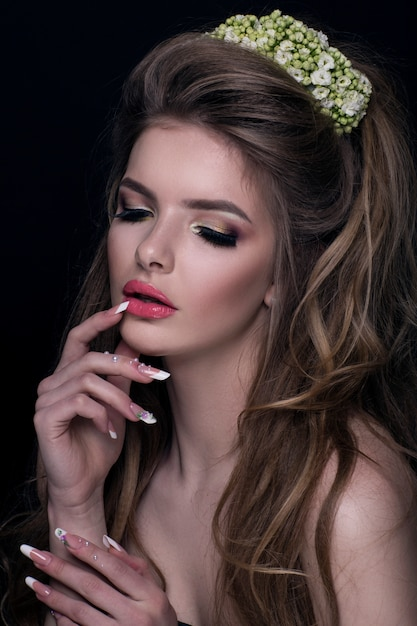 Fashion girl with flowers in her hair Premium Photo